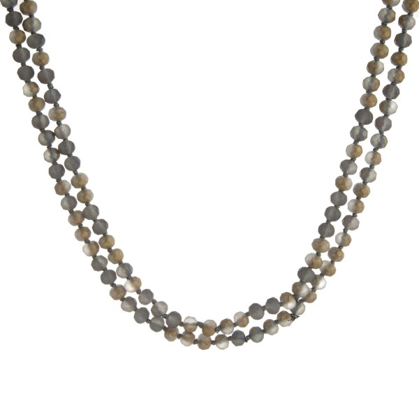 "Long necklace with faceted beads. Approximately 60"" in length."
