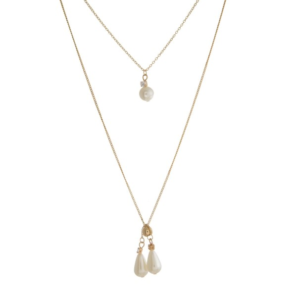 "Dainty, two layer necklace with pearl beaded pendants. Approximately 14"" and 24"" in length."