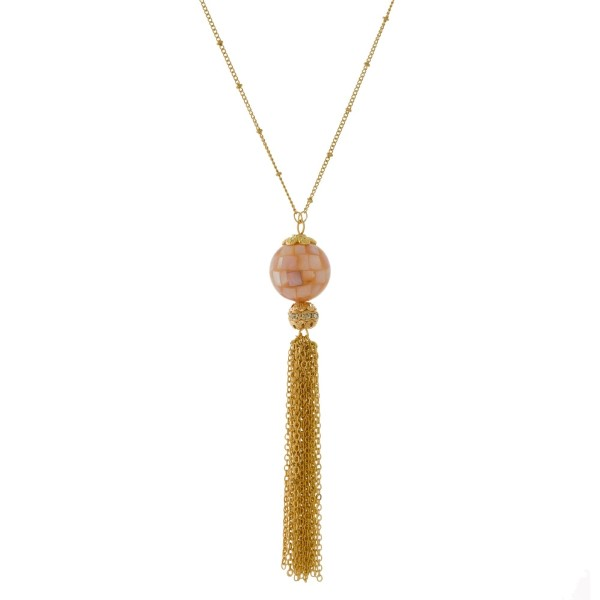 """Gold tone necklace with a natural stone, ball pendant and a chain tassel. Approximately 32"""" in length."""