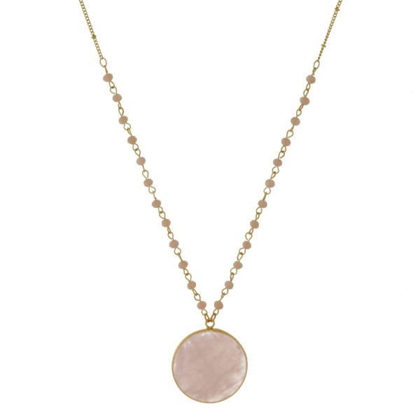 """Gold tone necklace with a faceted, natural stone, circle pendant. Approximately 30"""" in length."""