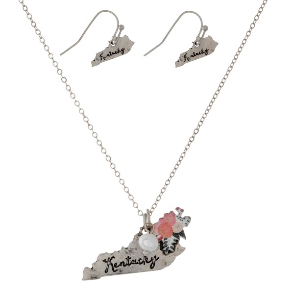 """Dainty silver tone necklace with a state pendant and a flower accent. Approximately 16"""" in length."""