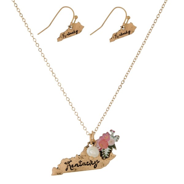 """Dainty gold tone necklace with a state pendant and a flower accent. Approximately 16"""" in length."""