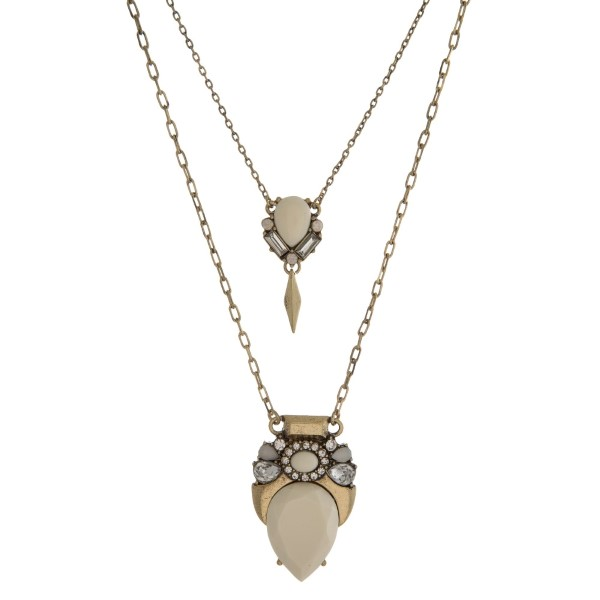 """Gold tone, two layer necklace with two epoxy stone and rhinestone pendants. Approximately 14"""" to 20"""" in length."""