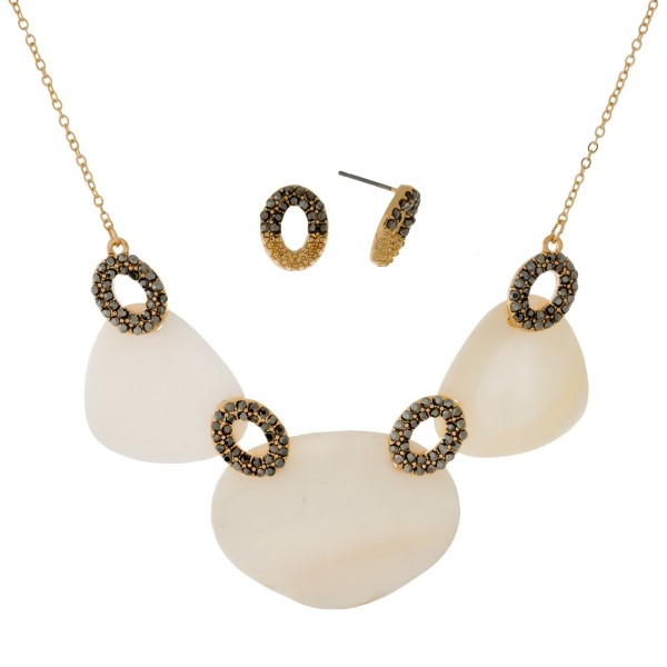 "Dainty necklace set with mother of pearl shells and matching stud earrings. Approximately 16"" in length."