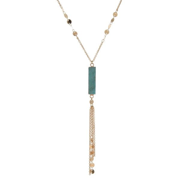 """Gold tone necklace with a natural stone, rectangle pendant and chain tassel. Approximately 32"""" in length."""