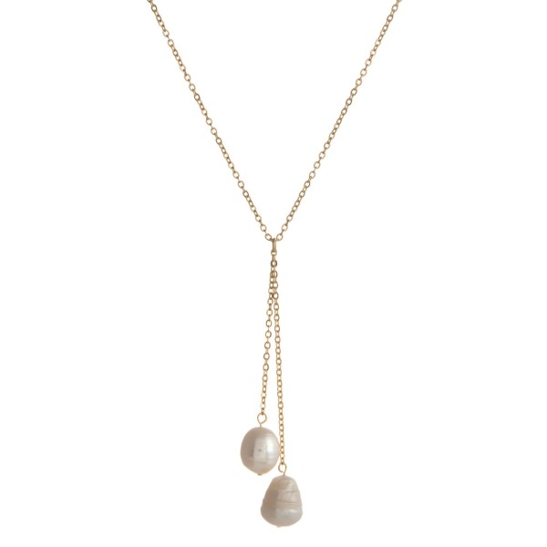 "Dainty, Y necklace with freshwater pearl details. Approximately 16"" in length."