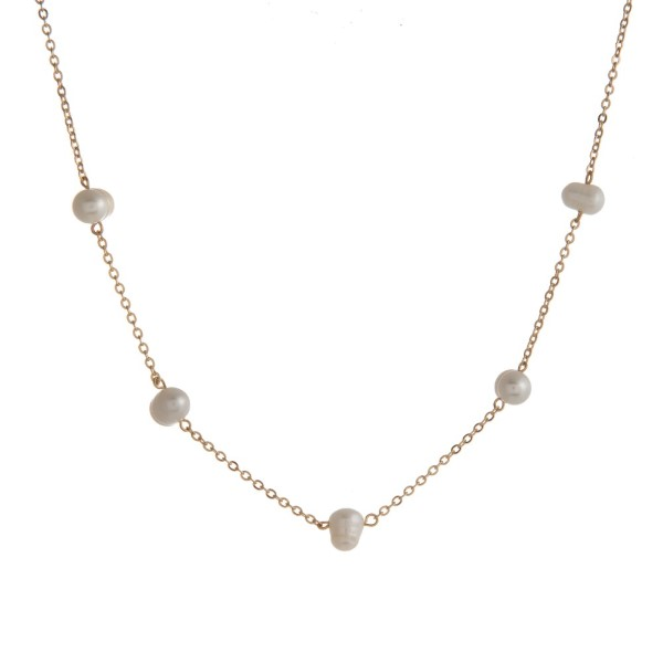 """Metal necklace with pearl details. Approximately 22"""" in length"""