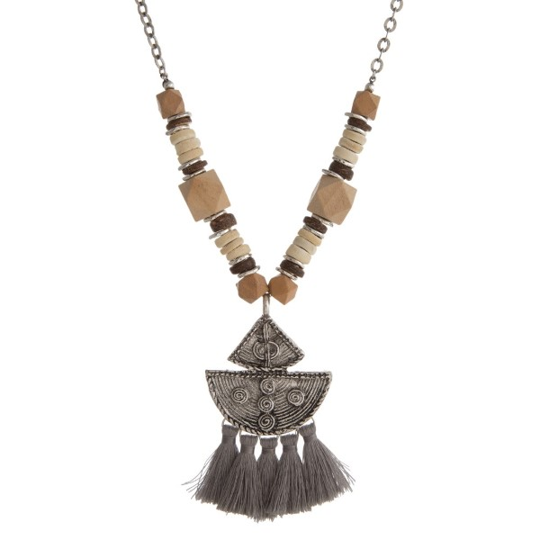 """Metal chain necklace with wooden beads, boho pendant, and soft tassels. Approximately 28"""" in length."""