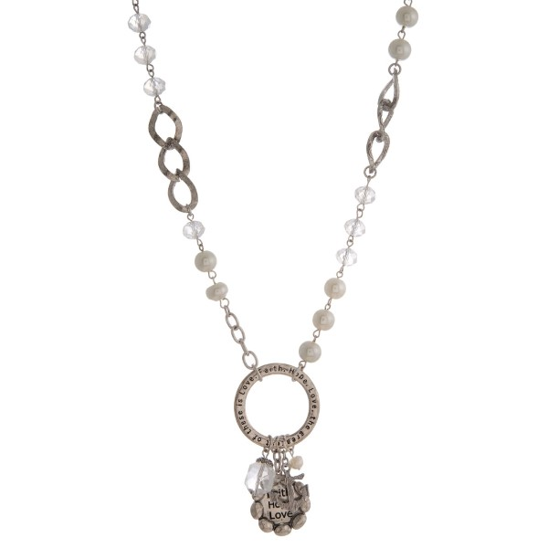 "Silver tone and pearl bead necklace with a stamped pendant. Approximately 30"" in length."