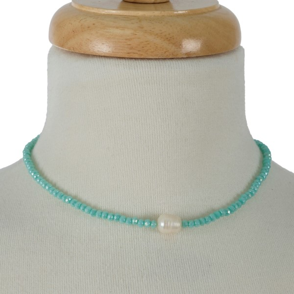 "Full beaded necklace with a freshwater pearl bead focal. Approximately 16"" in length."