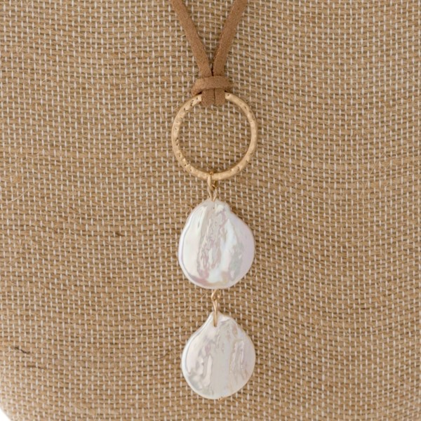 """Faux leather cord with fresh water pearl detail. Approximately 32"""" in length."""