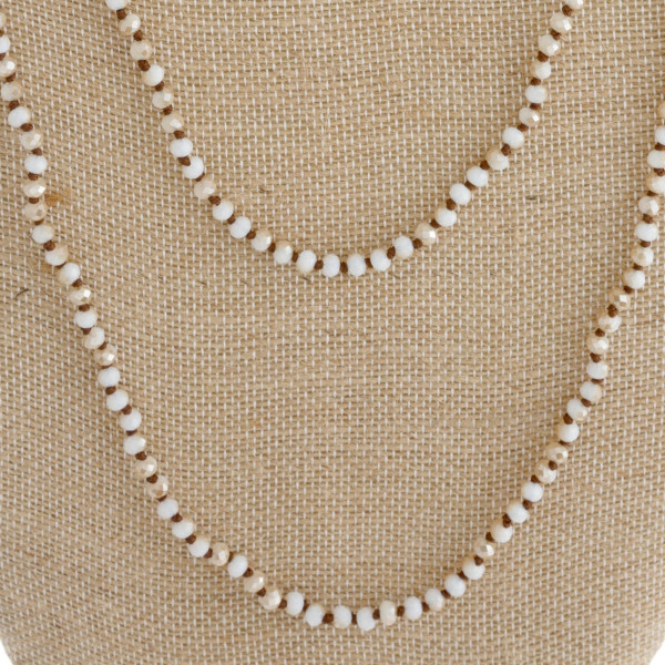 "Long necklace with faceted beads. Approximately 34"" in length."