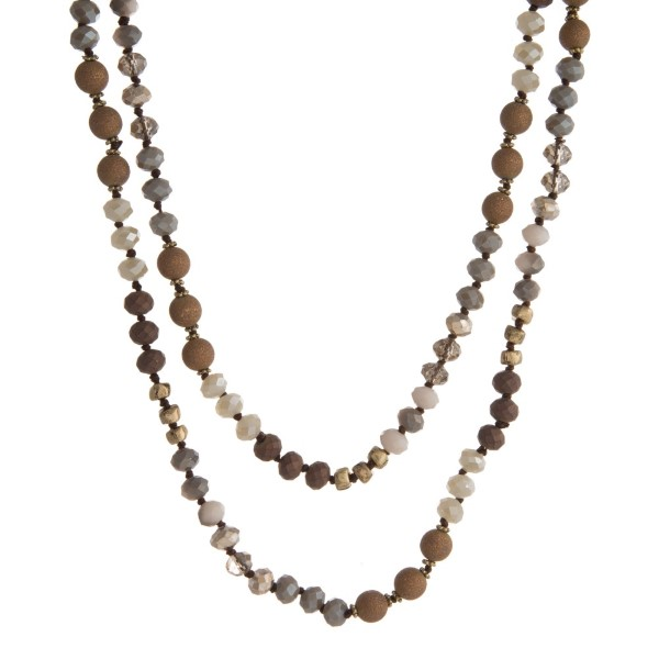 """Long necklace with metallic and faceted beads. Approximately 32"""" in length."""