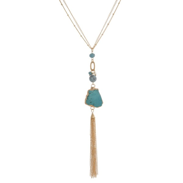 """Gold tone necklace with a natural stone pendant and chain tassel. Approximately 30"""" in length."""