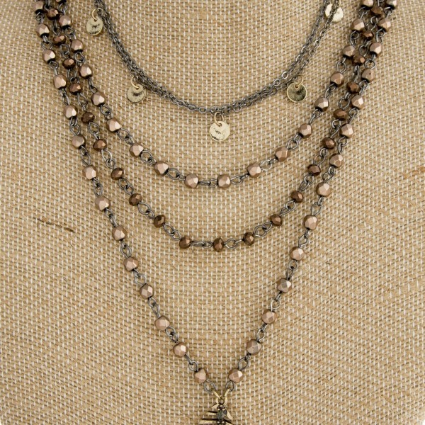 "Short layered necklace with faceted beads and feather pendant. Approximately  20"" in length."