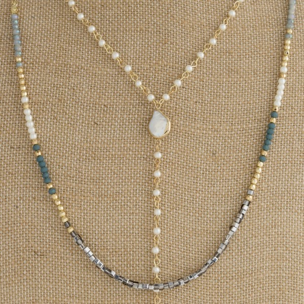 "Dainty layered necklace with pearl detail and faceted beads. Approximately 28-32"" in length."
