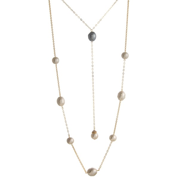 """Layered necklace with pearl detail. Approximately 20""""-32"""" in length."""