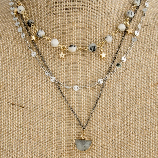 "Layered necklace with natural stone and star details. Approximately 18"" in length."