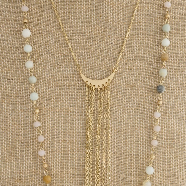 "Long layered necklace with natural stone beads and metal focal. Approximately 28"" in length."