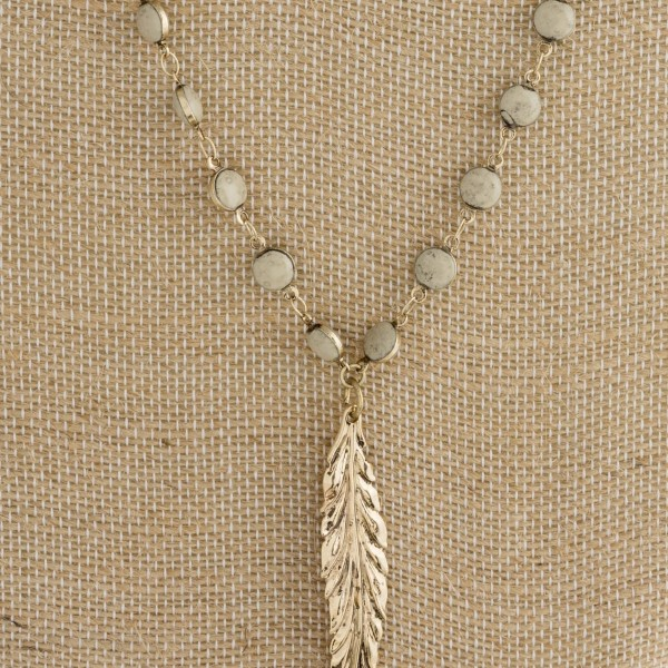 "Long layered necklace with feather pendant. Approximately 24""-32"" in length."