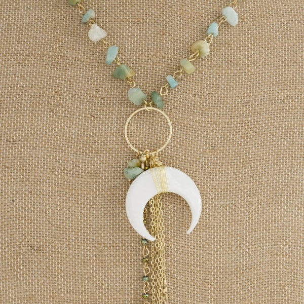 "Gold tone necklace with natural stone beads, horn pendant, and metal tassel. Approximately 32"" in length."