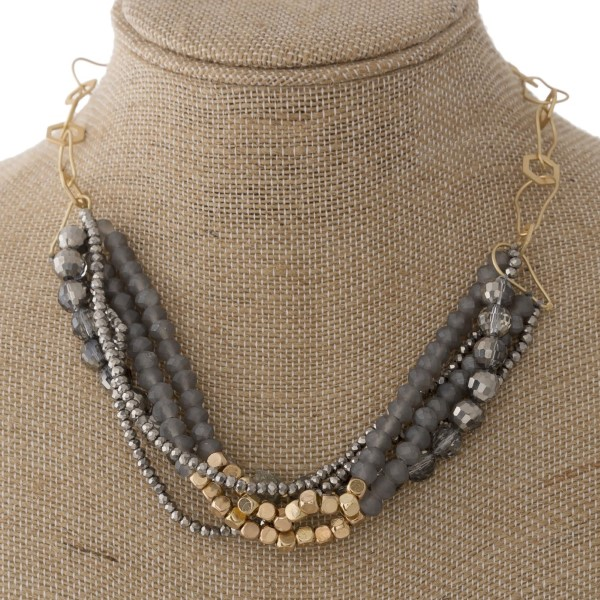"""Short gold tone necklace with faceted beads and druzy accent. Approximately 20"""" in length."""