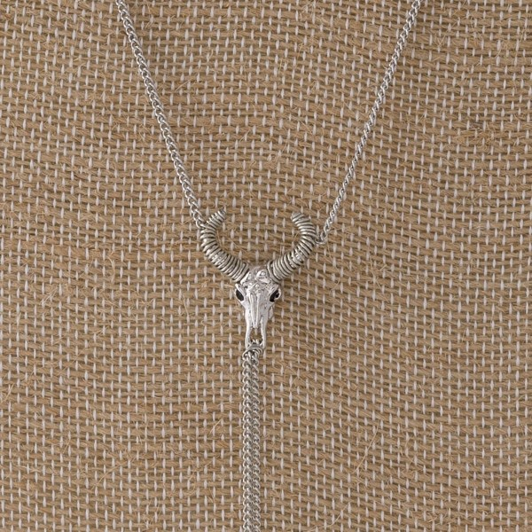 "Metal Y necklace with a steer head focal. Approximately 24"" in length."