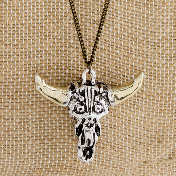 """Long metal necklace with steer head pendant. Approximately 32"""" in length."""