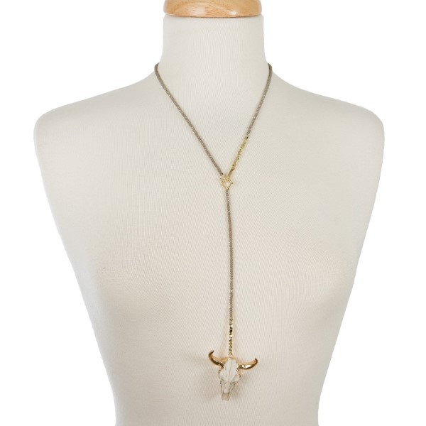 """Dainty Y necklace with a steer head skull pendant. Approximately 16"""" in length."""