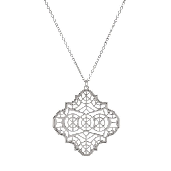 """Long, metal necklace with a filigree, quatrefoil pendant. Approximately 30"""" in length."""