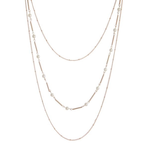 "Long, three layer necklace set with pearl beads and matching fishhook earrings. Approximately 22"" to 24"" in length."