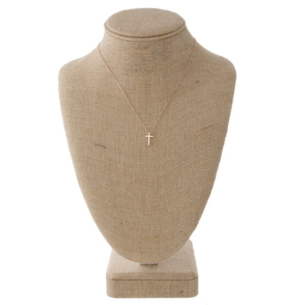"Dainty metal necklace with cross charm. Approximately 16"" in length with a 1/2"" charm."