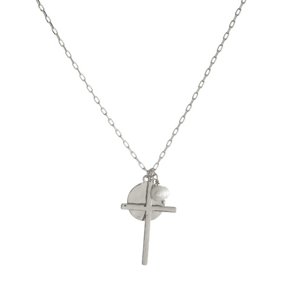 Short, metal necklace with cross and circle pendant. Approximately 16""