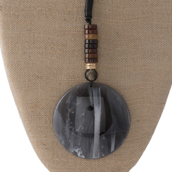 """Long leather cord necklace with acetate pendant. Approximately 30"""" in length with a 3"""" pendant."""