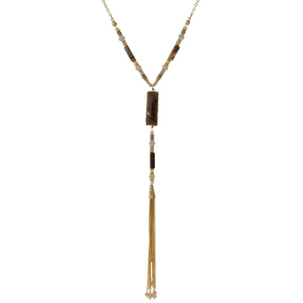 """Long, gold tone, Y necklace with faceted beads, a natural stone pendant, and a metal tassel. Approximately 30"""""""