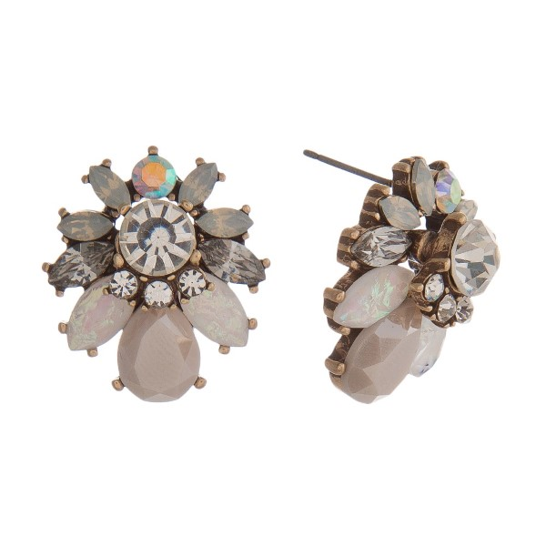 "Statement, post earring with rhinestone cluster. Approximately 1"" in length."