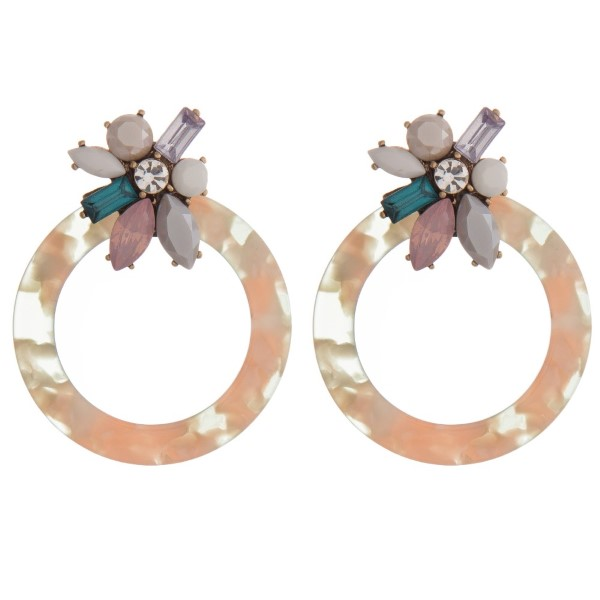 "Statement, post style earring with acetate circle and rhinestone detail. Approximately 2.5"" in length."