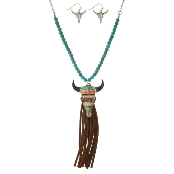 """Statement necklace set with a half beaded chain, steer head pendant, faux tassel pendant and matching fishhook earrings. Approximately 30"""" in length."""