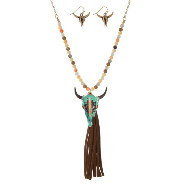 "Statement necklace set with a half beaded chain, steer head pendant, faux tassel pendant and matching fishhook earrings. Approximately 30"" in length."