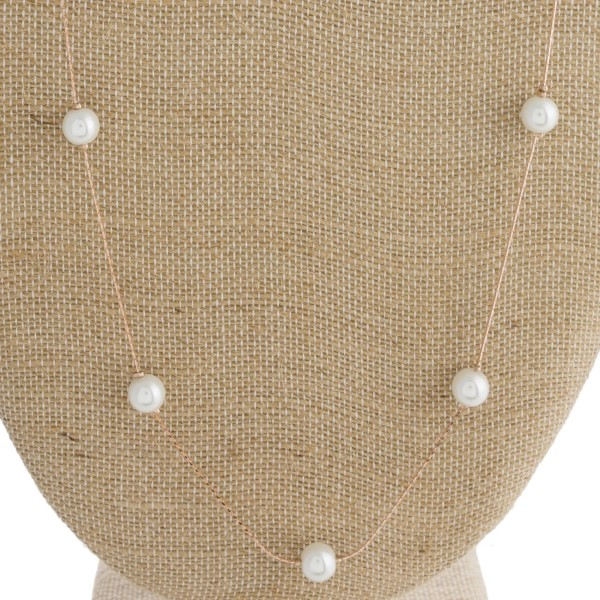 """Long metal necklace with pearl detail. Approximately 28"""" in length."""