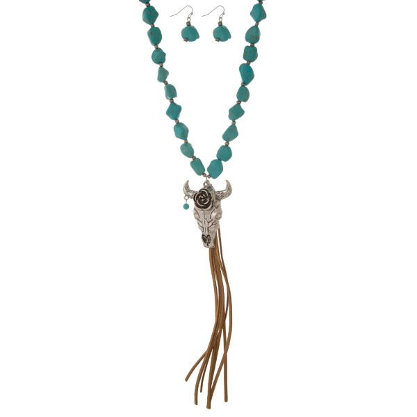 """Long necklace with natural stone accents, feather pendant, and suede tassel. Approximately 30"""" in length."""