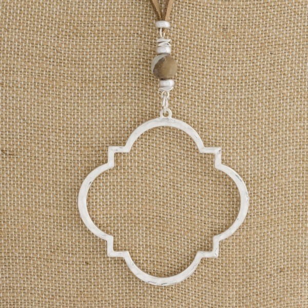 """Suede cord necklace with natural stone and quatrefoil shaped pendant. Approximately 32"""" in length."""