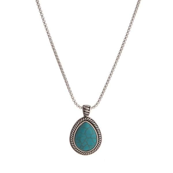 "Silver tone necklace with a teardrop turquoise pendant. Approximately 20"" in length."