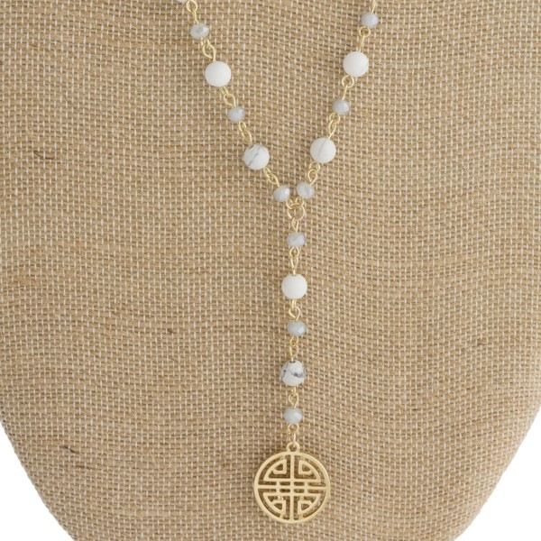 "Long, layered necklace with natural stone, faceted beads, and coin pendant. Approximately 18""-24"" in length."