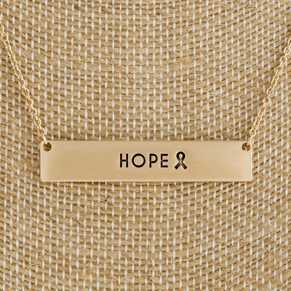 """Dainty tone necklace with a bar pendant, stamped with """"Hope"""". Approximately 16"""" in length."""
