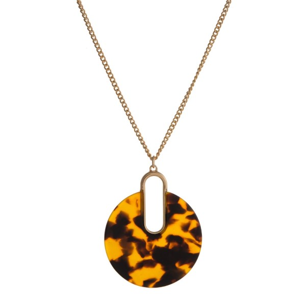 "Gold tone necklace with circle acetate pendant. Approximately 32"" in length."