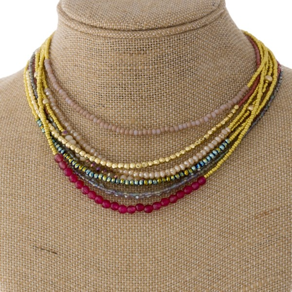 "Layered statement necklace with faceted and glass beads. Approximately 20"" in length."