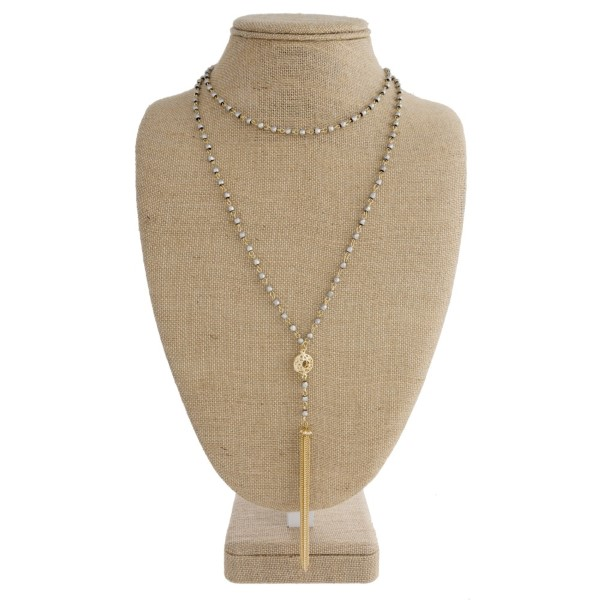 """Layered necklace with metal tassel. Approximately 16""""-30"""" in length."""