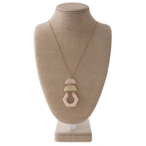 """Long gold tone necklace with geometric shape acetate pendant. Approximately 32"""" in length."""