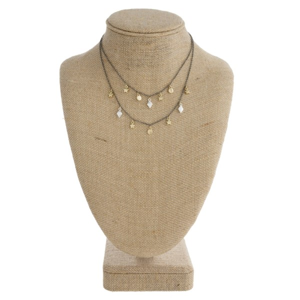 "Layered necklace with dainty charms. Approximately 16"" in length."